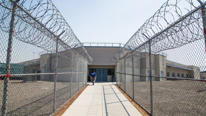 Entrance to the Arizona State Prison Complex -Kingman. A riot one year ago damaged much of the prison, but since then, a new operator, GEO Group, has taken over. The facility is being sold to the state by private bondholders.
