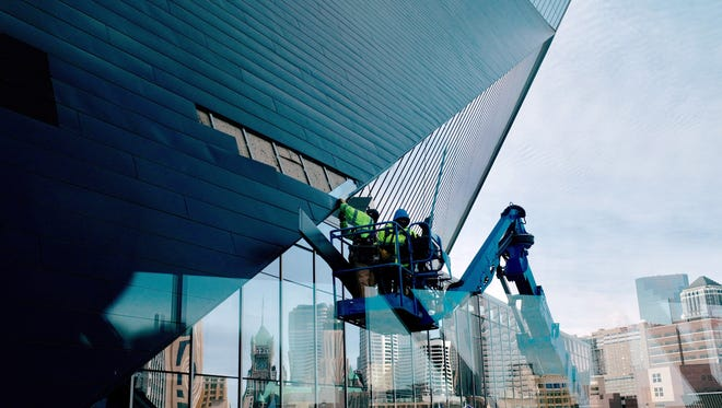 Crews repaired damaged panels on the northern face of US Bank Stadium. Winds gusting to 60 miles per hour earlier in the week had damaged a number of panels that cover the stadium. Photographed Friday, March 10, 2017 at US Bank Stadium. ---- Mark Vancleave/Minneapolis Star Tribune
