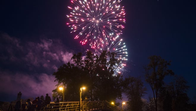 Fireworks light up the night sky in Groveland Oaks County Park on July 1, 2017, in Holly, Mich.