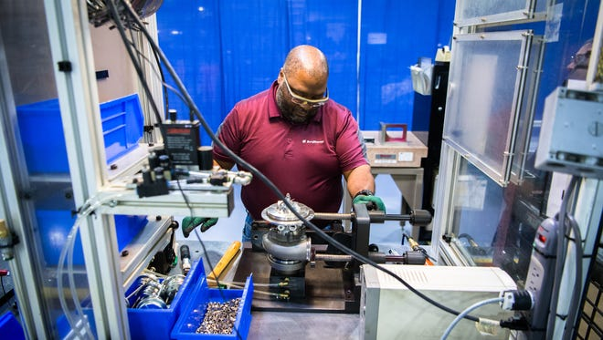 A Borg Warner employee works in their manufacturing facility's EFR work area.