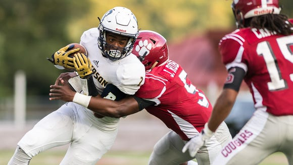 Roberson's Kobe Miles is tackled by Asheville's Jordan