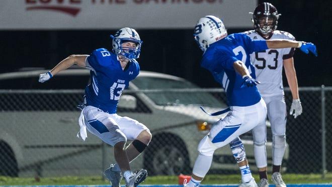 Brevard high school's Luke Ellenberger and Breylan Owens jump up in celebration after Ellenberger's touchdown against Owen Thursday, September 14, 2017.