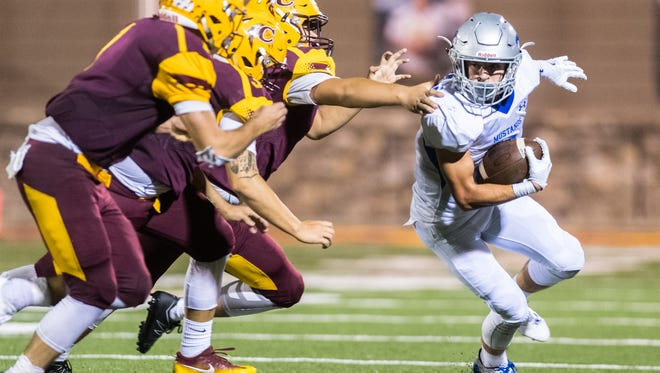 Smoky Mountain high school's Cody Lominac runs the ball during their game against Cherokee high school Friday, September 15, 2017.