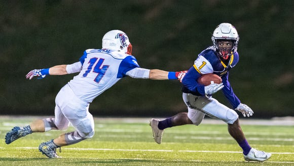 North Henderson's Darren Lammons is chased by West