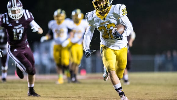 Murphy's Slade Mctaggart runs the ball during their