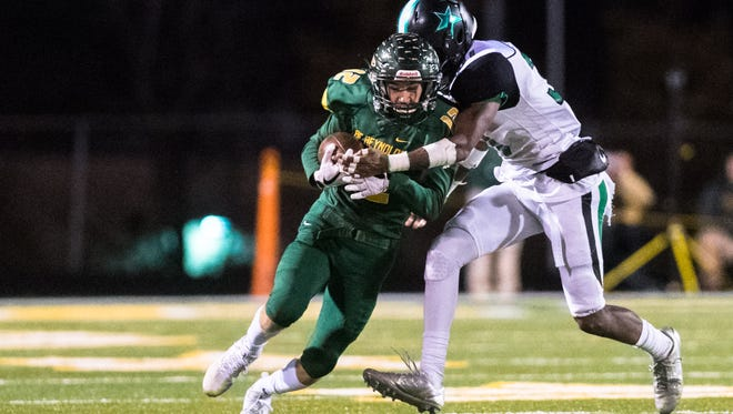 Reynolds' Nathan St. Onge is tackled by Southwest Guilford's Jalin Virgo during their game Friday, November 17, 2017.