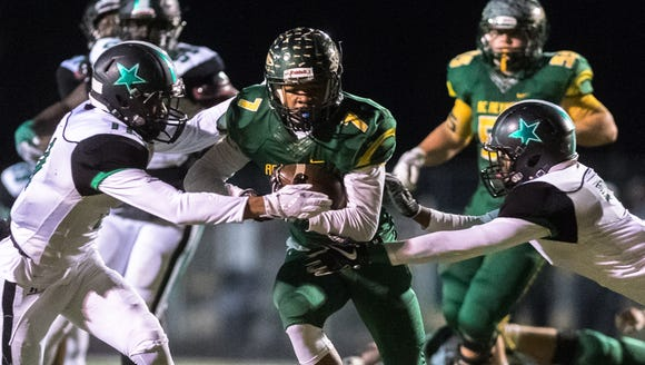 Reynolds' I'dre Bell is tackled by Southwest Guilford's