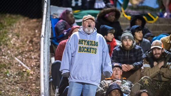 """""""Ronnie The Rocket"""" cheers at Reynolds' football game against Southwest Guilford Friday, November 17, 2017."""