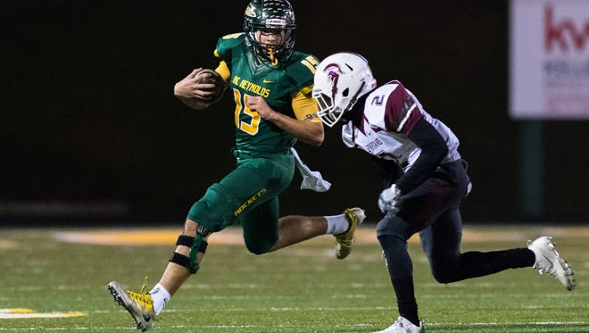 Reynolds' Alex Flinn runs the ball during their game against Sun Valley Friday, December 1, 2017. Reynolds' defeated Sun Valley 28-25, advancing them to the state championships.