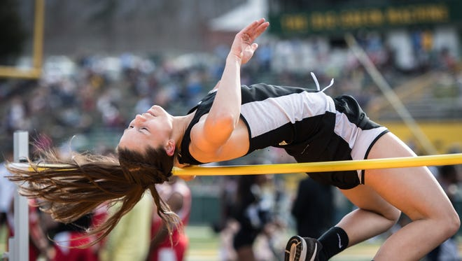 McKena Phillips, of Enka, competes in the high jump event at the Buncombe County track and field championships held at Reynolds high school Wednesday, March 28, 2018.