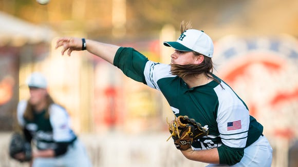 East Henderson's Jerred Davis throws a pitch to North Henderson at McCormick Field in Asheville Tuesday, April 3, 2018. North Henderson won 7-4 in seven innings.