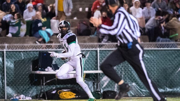 Southwest Guilford's Jaren Rainey makes a catch, running the ball into the end zone for their only touchdown during their game against Reynolds' Friday, November 17, 2017.