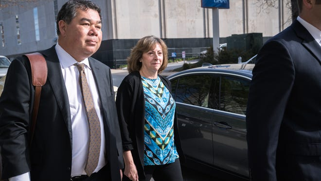 Wanda Greene, former Buncombe County manager, walks to the federal courthouse in Asheville with her attorney Noell Tin, and Thomas Amburgey for her arraignment on her charges of wire fraud, conspiracy, embezzlement and aiding and abetting Thursday, April 13, 2018.