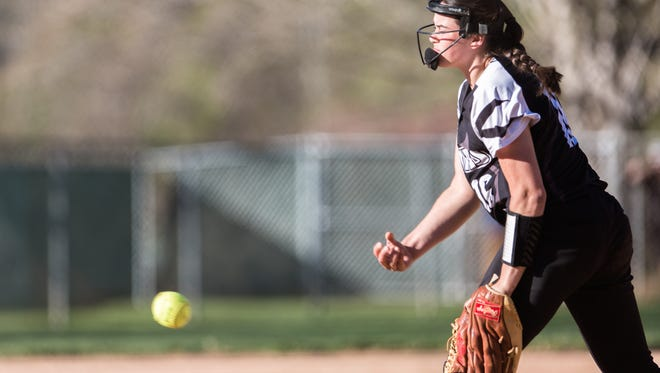 North Buncombe's Caitlin Griffin throws a pitch to Reynolds during their game Friday, April 20, 2018. North Buncombe won 8-7 in seven innings.