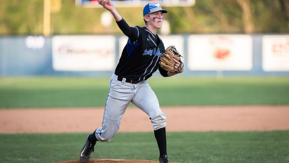 Smoky Mountain pitcher Zebby Matthews throws to first