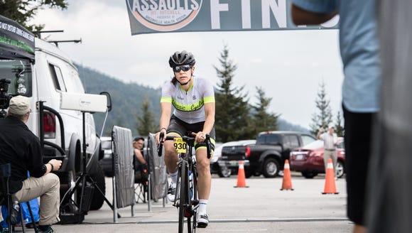 Jenny Leiser, 38, of Charlotte, crosses the finish