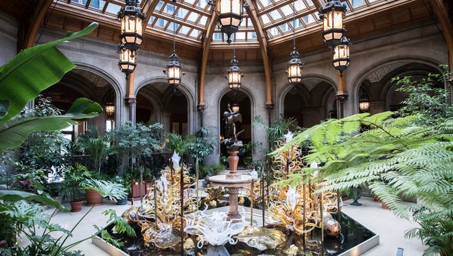 A piece titled, Laguna Torcello II, in the Winter Garden in the Biltmore house, which is part of the Chihuly at Biltmore exhibition of a collection of Dale Chihuly's work.