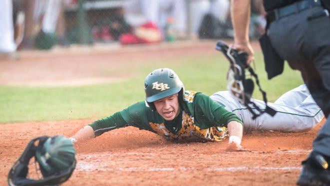 Reynolds' Jalen Crowder dives across home plate during their game one of their regional finals series against Crest Wednesday, May 23, 2018, defeating Crest 5-1.