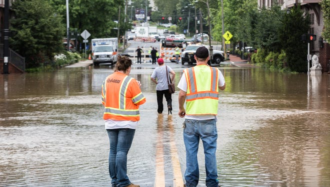 Biltmore Avenue and Hendersonville Road were under water Wednesday morning in Biltmore Village as a result of heavy rain in Buncombe County.