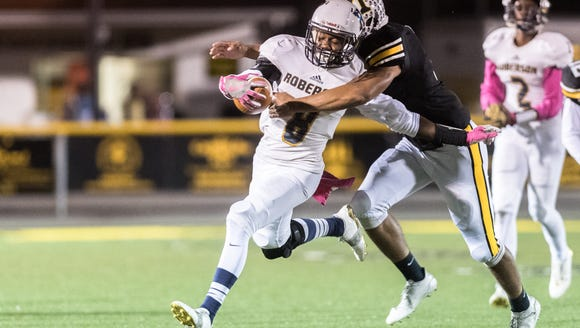 Tuscola's Brandon Cullins tackles Roberson's Shak Hill