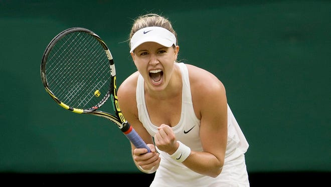 Canadian Eugenie Bouchard celebrates match point against France's Alize Cornet at Wimbledon on Monday.