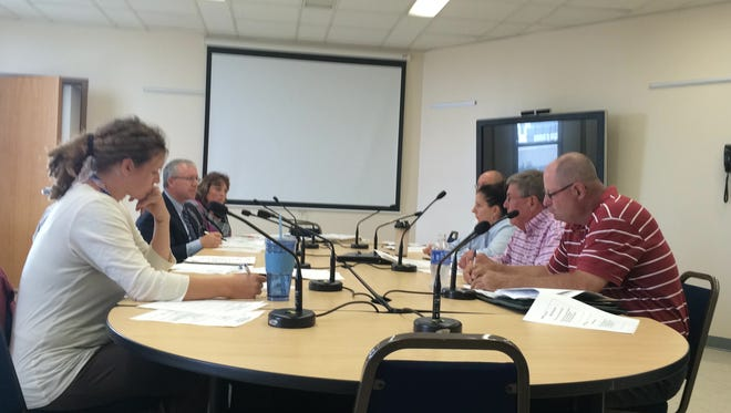 Oshkosh Common Councilors and city staff members discuss 2015 budget projections during a workshop Tuesday.