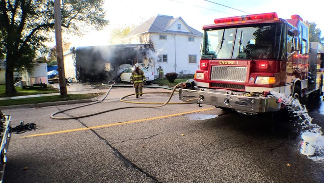 Firefighters respond to a Wisconsin Rapids house fire, Tuesday, Sept. 30, 2014.