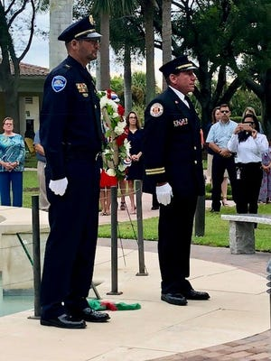 A poignant  ceremony is held the morning of Sept. 11, as Village of Tequesta Fire Rescue and Police Department officials recall the tragic day 17 years ago, during a ceremony in front of the Village's 9-11 Memorial. Police Lt James Pike, at left, and Fire Rescue Lt. Dan Tillis are pictured.