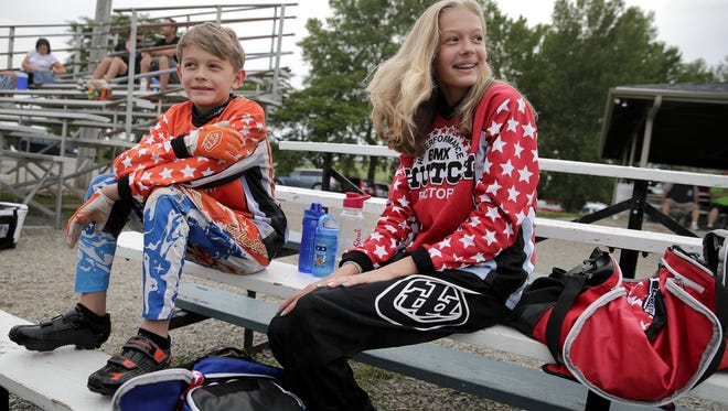 Cole DeBruin, 11, sits with his sister, Emma DeBruin, 13, while waiting for their second race to start at Winnebagoland BMX in the town of Oshkosh on July 19.