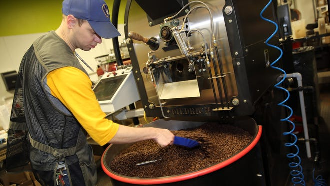 Michael Cothroll, a roaster production manager at Valentine Coffee Roasters, monitors a roast.