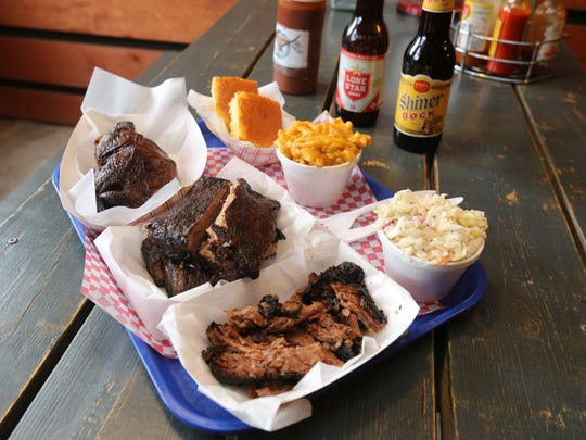 The 3 Meat Combo Platter, with Chicken, St. Louis Ribs, Brisket, and Jalape–o Mac and Cheese, Coleslaw, Cornbread and Lone Star and Shiner Bock beer at the Roundup Texas BBQ & Tumbleweed Saloon on Route 9 in Cold Spring, Feb. 22, 2017.