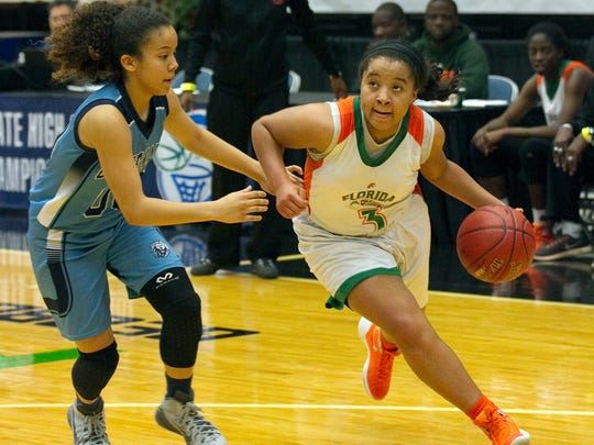 FAMU High School's LaKrista Walker (3) drives toward the basket as Covenant Christian School's Jasmine Peaks (00) tries to defend during the second half of their FHSAA Girls 2-A Semifinal game at The Lakeland Center Tuesday. FAMU won the game 76-55. February 16, 2016 MICHAEL WILSON/THE LEDGER
