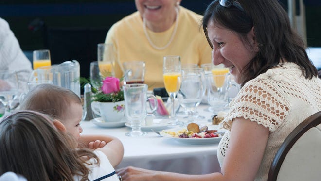 "Veronica Chambers, far right, smiles at daughters Emma and Vivian during Mother's Day brunch at the Ronald Reagan Presidential Library in Simi Valley in 2013. The event this year will include visits to ""Interactive: The Exhibition."""