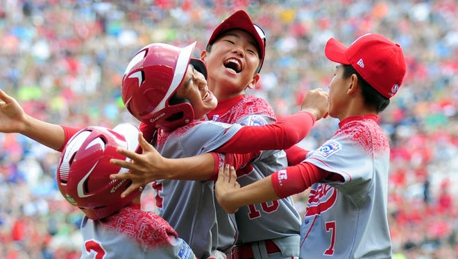 Japan celebrates its nail-biting victory over Mexico at the Little League World Series.