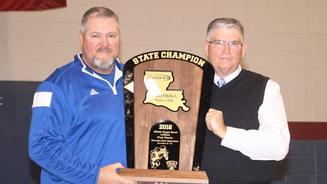Thompson hoists Sterlington's 2016 Class 2A football state championship trophy with former principal Dell Ashley. Ashley retired at the conclusion of the 2017-18 school year.