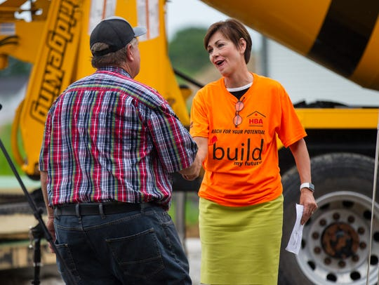 Iowa Gov. Kim Reynolds shakes hands with Tim Ruth during