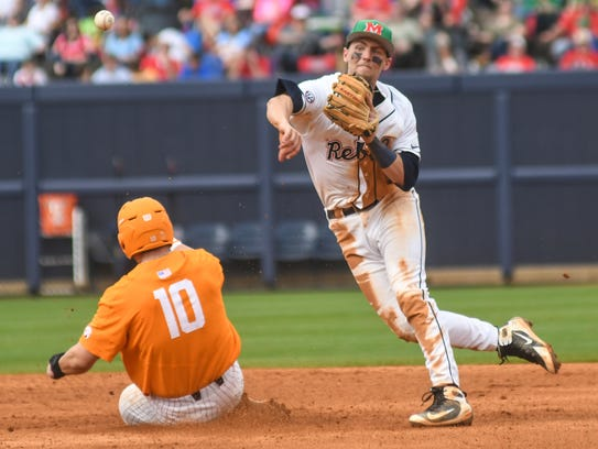 Mississippi's Grae Kessinger (15) forces out Tennessee's