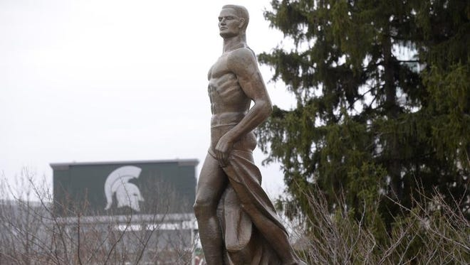 MSU's Sparty statue cleaned up on campus Thursday 4/16/2015 after an overnight  paint attack.