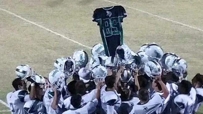 After Miami defeated San Tan Foothills last week, players celebrated its first sectional championship in 24 years, holding up jersey No.89, worn by 15-year-old teammate Triston DalMolin, who died on July 30, just before the start of football practices.
