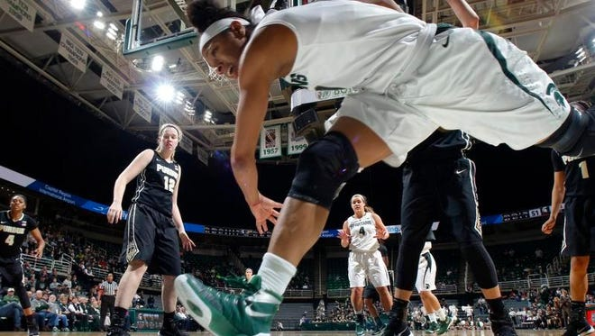 Michigan State's Branndais Agee dives for a loose ball against Purdue Wednesday.