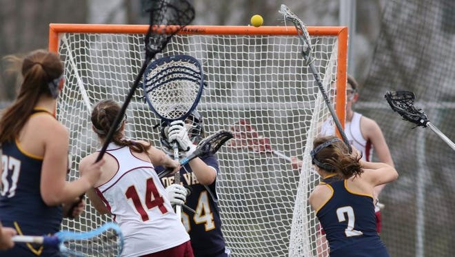 Hillsborough's Gianna Napoletano (14) scores a goal as Delaware Valley's  Hannah Oliveras (54) tries to defend on Thursday at Hillsborough.