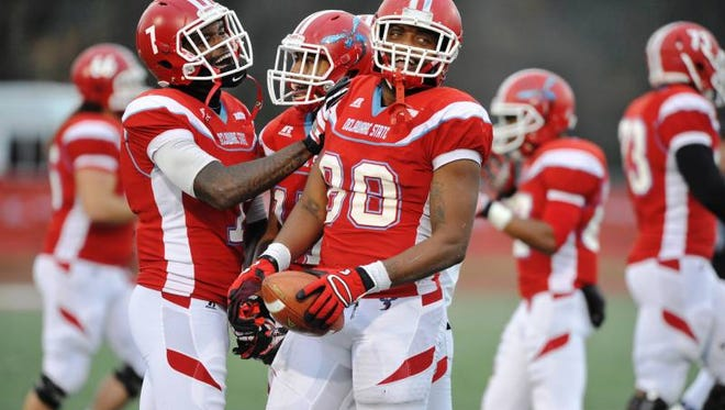 New MSU defensive end Gabe Sherrod, right, earned HBCU All-America honors last season at Delaware State.