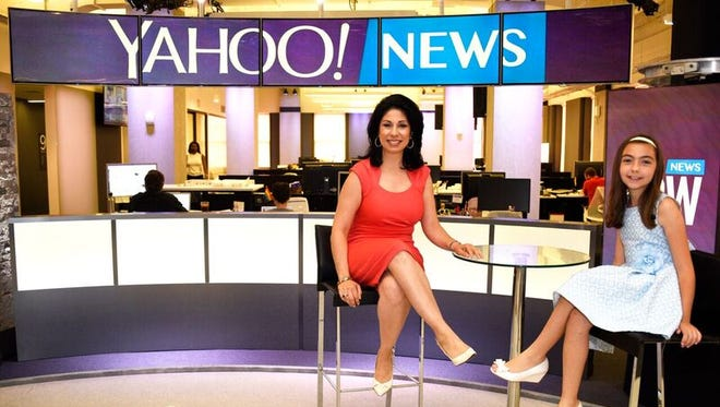 Yahoo Finance news anchor Alexis Christoforous and 10-year-old Nicole Poulos of Bronxville.