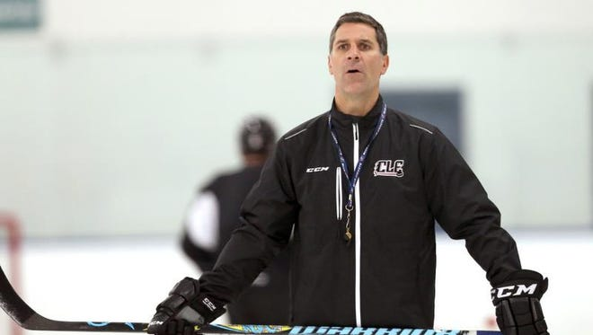 Lake Erie Monsters coach Jared Bednar watches practice at the OBM Arena in Strongsville, Ohio. The Colorado Avalanche have hired Bednar as their new head coach.