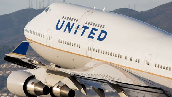 A United Airlines Boeing 747 takes off for Hong Kong