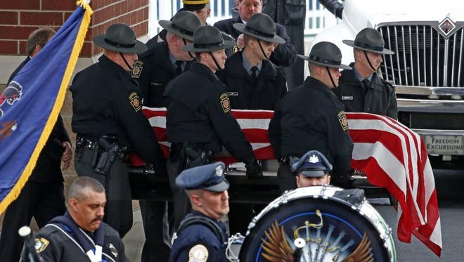 Pennsylvania State Trooper Landon E. Weaver's casket is carried to a hearse by troopers after a memorial service at the Blair County Convention Center in Altoona, Pa., Thursday, Jan. 5, 2017. Trooper Weaver was killed answering a domestic disturbance call on Dec. 30. Weaver, 23, had been on the force for less than six months. (AP Photo/Gene Puskar)