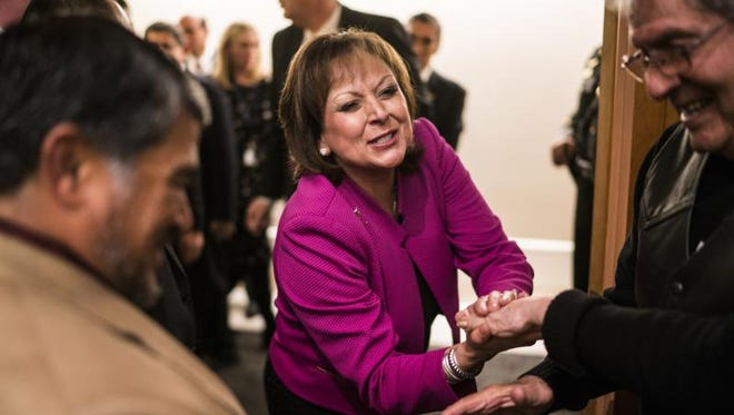 New Mexico Gov. Susana Martinez congratulated by supporters after she gave her State of the State address, Tuesday, Jan. 17, 2017, in Santa Fe.