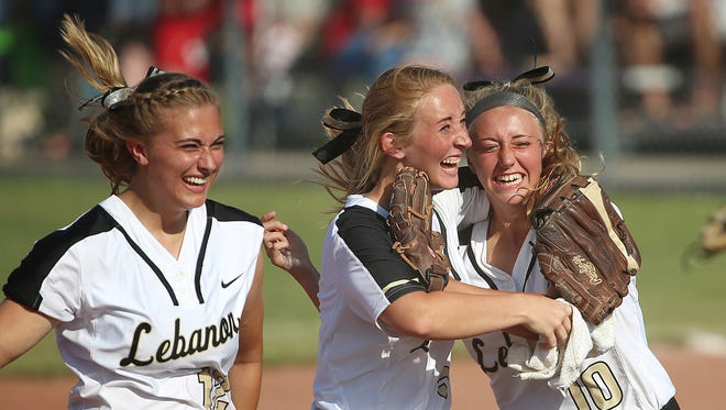 From left, Lebanon's Laura Patterson (12), Hannah Wirey (5) and Abigail Wirey (10) celebrate after winning the class 3A softball state finals against Kankakee Valley, at Ben Davis High School, Indianapolis, Saturday, June 11, 2016. Lebanon won, 2-1.