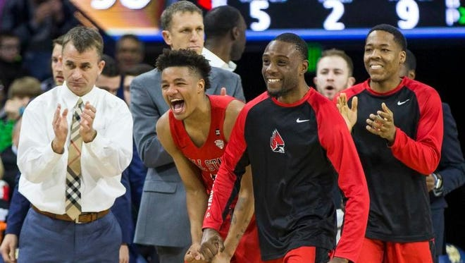 Ball State head coach James Whitford and  players Ishmael El-Amin, Francis Kiapway and Josh Thompson react to a play during the Cardinals' 80-77 victory Tuesday, Dec. 5 at Notre Dame.