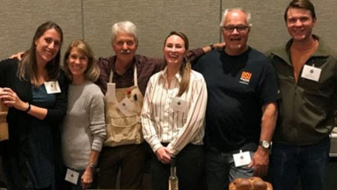 Barley Project members at The Plant Variety Showcase (October 12, 2017, Portland, OR) showcase breads made from Buck (and other naked barleys) in the foreground. From left to right: Brigid Meints, Rebecca Hayes, Patrick Hayes, Laura Helgerson, Andrew Ross, and Scott Fisk.